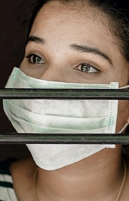 Woman Wearing Face Mask Crying