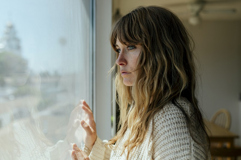 woman thinking of her childhood trauma in current state