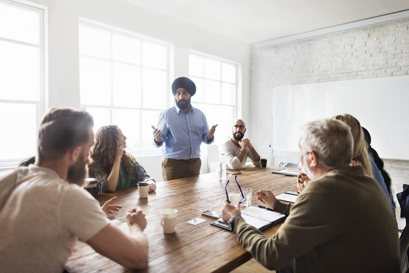 person addressing audience in meeting - time organization skills that can help you in work and life