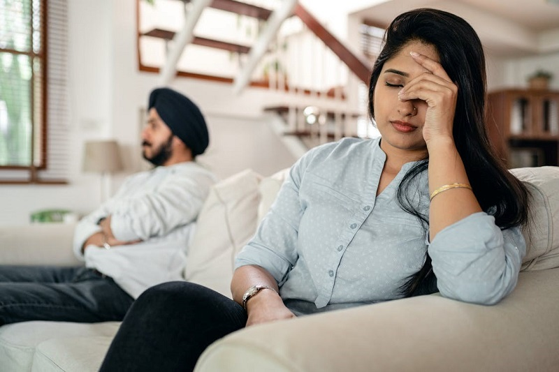 Upset young Indian couple after conflict