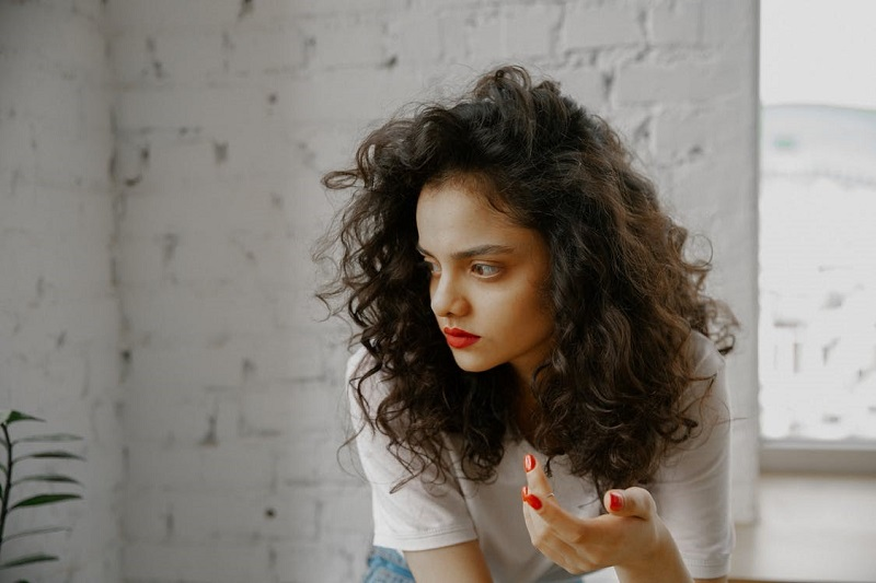 Woman with Red Lipstick and Red Nail Polish