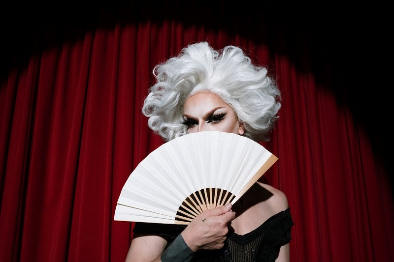 Drag Queen Holding White Hand Fan